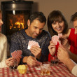 Group Of Middle Aged Couples Playing Cards Together — Stock Photo #11891635