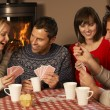 Group Of Middle Aged Couples Playing Cards Together — Stock Photo #11891645
