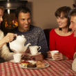 Group Of Middle Aged Couples Enjoying Tea And Cake Together — Stock Photo #11891649
