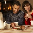 Group Of Middle Aged Couples Enjoying Tea And Cake Together — Stock Photo #11891652