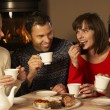 Group Of Middle Aged Couples Enjoying Tea And Cake Together — Stock Photo