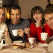 Group Of Middle Aged Couples Enjoying Tea And Cake Together — Stock Photo #11891657