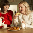 Two Middle Aged Women Enjoying Tea And Cake Together — Stock Photo