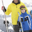 Stock Photo: Father And Son On Ski Holiday In Mountains