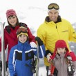 Family On Ski Holiday In Mountains — 图库照片