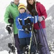Group Of Children On Ski Holiday In Mountains — Stock Photo #11891729