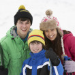 Group Of Children On Ski Holiday In Mountains — Stock Photo #11891742