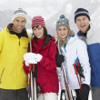Group Of Middle Aged Couples On Ski Holiday In Mountains — Stock Photo