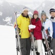 Group Of Middle Aged Couples On Ski Holiday In Mountains — Stock Photo #11891758