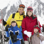Family On Ski Holiday In Mountains — Stock Photo