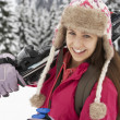 Teenage Girl On Ski Holiday In Mountains - ストック写真
