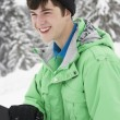 Teenage Boy With Snowboard On Ski Holiday In Mountains — Foto Stock