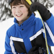 Stock Photo: Young Boy With Snowboard On Ski Holiday In Mountains