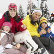 Family Eating Sandwich On Ski Holiday In Mountains — Stock Photo