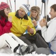 Group Of Middle Aged Friends Eating Sandwich On Ski Holiday In M - Stock Photo