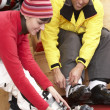 Stock Photo: Couple On Trying On Ski Boots In Hire Shop