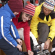 Stock Photo: Family Trying On Ski Boots In Hire Shop