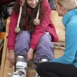 Sales Assistant Helping Teenage Girl To Try On Ski Boots In Hire — Stock Photo #11891998
