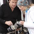 Sales Assistant Helping Advising Female Customer On Ski Boots In — Stock Photo #11892006