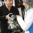 Sales Assistant Helping Advising Female Customer On Ski Boots In — Stock Photo #11892014