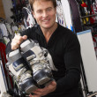 Sales Assistant With Ski Boots In Hire Shop — Stock Photo
