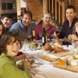 Two Familes Enjoying Meal In Alpine Chalet Together — Stock Photo #11892034