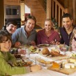Two Familes Enjoying Meal In Alpine Chalet Together — Stock Photo #11892039