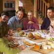 Two Familes Enjoying Meal In Alpine Chalet Together — Stock Photo