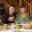 Stock Photo: Family Enjoying Meal In Alpine Chalet Together