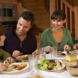 Family Enjoying Meal In Alpine Chalet Together — Stock Photo #11892050