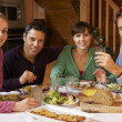 Group Of Friends Enjoying Meal In Alpine Chalet Together — Stock Photo #11892055