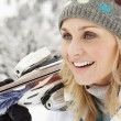 Stock Photo: Middle Aged WomOn Ski Holiday In Mountains