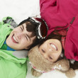 Overhead View Of Two Teenagers On Ski Holiday In Mountains — Stock Photo #11892286