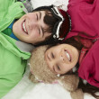 Royalty-Free Stock Photo: Overhead View Of Two Teenagers On Ski Holiday In Mountains