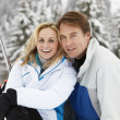 Middle Aged Couple On Ski Holiday In Mountains - ストック写真