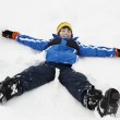 Young Boy Making Snow Angel On Slope — Stock Photo #11892337