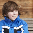 Boy Dressed For Cold Weather Sitting On Wooden Bench — Stok fotoğraf