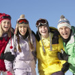 Teenage Family On Ski Holiday In Mountains — Stock Photo #11892453