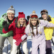 Teenage Family On Ski Holiday In Mountains — Stock Photo #11892463