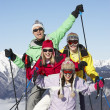 Stock Photo: Teenage Family On Ski Holiday In Mountains