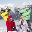 Teenage Family Having Snow Fight In Mountains - Stockfoto