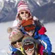 Stock Photo: Group Of Children Having Fun On Ski Holiday In Mountains