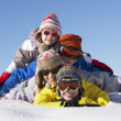 Royalty-Free Stock Photo: Group Of Children Having Fun On Ski Holiday In Mountains