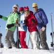 Stock Photo: Group Of Middle Aged Couples On Ski Holiday In Mountains