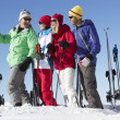Group Of Middle Aged Couples On Ski Holiday In Mountains — Stock Photo #11892486