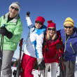 Group Of Middle Aged Couples On Ski Holiday In Mountains — Stock Photo #11892488