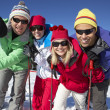 Group Of Middle Aged Couples On Ski Holiday In Mountains — Stock Photo #11892491