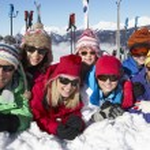 Two Family Having Fun On Ski Holiday In Mountains — Stock Photo