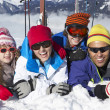 Stock Photo: Family Having Fun On Ski Holiday In Mountains