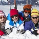 Family Having Fun On Ski Holiday In Mountains — Stock Photo